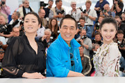 """Actress Gong Li, director Yimou Zhang and actress Huiwen Zhang attend the """"Coming Home"""" photocall at the 67th Annual Cannes Film Festival on May 20, 2014 in Cannes, France."""