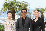 """Actors Huiwen Zhang, Daoming Chen and Gong Li attend the """"Coming Home"""" photocall at the 67th Annual Cannes Film Festival on May 20, 2014 in Cannes, France."""