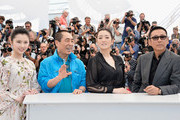 """(L-R) Actress Huiwen Zhang, director Yimou Zhang, actress Gong Li and actor Daoming Chen attend the """"Coming Home"""" photocall at the 67th Annual Cannes Film Festival on May 20, 2014 in Cannes, France."""