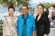 """(L-R) Actrss Huiwen Zhang, director Yimou Zhang  and actress Gong Li attend the """"Coming Home"""" photocall at the 67th Annual Cannes Film Festival on May 20, 2014 in Cannes, France."""