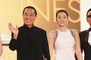 "Zhang Yimou and Gong Li attend the ""Gui Lai"" premiere during the 67th Annual Cannes Film Festival on May 20, 2014 in Cannes, France."