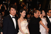 "(2nd) Zhang Huiwen and Zhang Yimou attend the ""Gui Lai"" premiere during the 67th Annual Cannes Film Festival on May 20, 2014 in Cannes, France."
