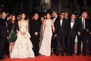 "(3rd L-R) Zhang Huiwen,Zhang Yimou, Gong Li, Chen Daoming and Zhang Zhao attend the ""Gui Lai"" premiere during the 67th Annual Cannes Film Festival on May 20, 2014 in Cannes, France."