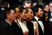 "Zhang Zhao, Chen Daoming, Gong Li and Zhang Yimou attend the ""Gui Lai"" premiere during the 67th Annual Cannes Film Festival on May 20, 2014 in Cannes, France."