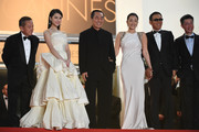 "(2ndL)  Zhang Huiwen, director Zhang Yimou, actress Gong Li,  actor Chen Daoming and producer Zhang Zhao attend the ""Gui Lai"" premiere during the 67th Annual Cannes Film Festival on May 20, 2014 in Cannes, France."
