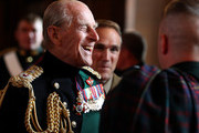 EDINBURGH, UNITED KINGDOM- JULY 03:   Prince Philip, Duke of Edinburgh speaks with guests in the Great Hall as he attended a commemorative service for the Scottish National War Memorial at Edinburgh Castle on July 3, 2014 in Edinburgh, Scotland.