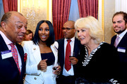 Alexandra Burke (L) and Camilla, Duchess of Cornwall (R) attend the Commonwealth Day reception 2020 on March 9, 2020 in London, England.