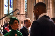 Meghan, Duchess of Sussex (L) talks with British boxer Anthony Joshua as she leaves after attending the Commonwealth Day Service 2020 on March 9, 2020 in London, England.
