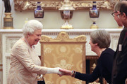 Queen Elizabeth II greets Prime Minister Theresa May at a reception to celebrate the Commonwealth Diaspora community, in the lead up to the Commonwealth Heads of Government meeting in London this April, at Buckingham Palace on February 14, 2018 in London, England.