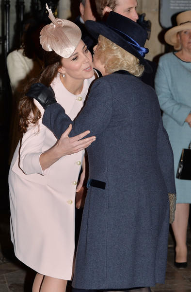 Catherine, Duchess of Cambridge greets Camilla, Duchess of Cornwall as they attend the Observance for Commonwealth Day Service At Westminster Abbey on March 9, 2015 in London, England.