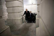 Senate Majority Leader Mitch McConnell (L) (R-KY) returns to the U.S. Capitol just before midnight February 8, 2018 in Washington, DC. After a delay caused by Sen. Rand Paul (R-KY), both the Senate and the House of Representatives are expected to vote in the early morning on a long term funding bill following an agreement between Republican and Democratic leaders in the U.S. Senate.