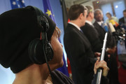 A journalist extends a microphone to U.S. Senator Chris Murphy, German Foreign Minister Guido Westerwelle and U.S. Congress member Gregory Meeks speaking to the media at the Foreign Ministry on November 25, 2013 in Berlin, Germany. The two American officials are in Berlin in an effort to mend relations between the two countries that have been under strain since revelations that the National Security Agency (NSA) had eavesdropped on the mobile phone of German Chancellor Angela Merkel over a multi-year period.
