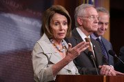 U.S. House Minority Leader Rep. Nancy Pelosi (D-CA) (2nd L) speaks as (L-R) Assistant House Minority Leader Rep. James Clyburn (D-SC), Senate Minority Leader Sen. Harry Reid (D-NV), and Sen. Charles Schumer (D-NY) listen during a news conference October 1, 2015 at the U.S. Capitol in Washington, DC.