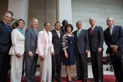 (L-R)  Sen. Chuck Schumer (D-NY), House Minority Leader Nancy Pelosi (D-CA),  Senate Minority Leader Mitch McConnell (R-KY), Delegate Eleanor Holmes Norton (D-DC), Kenneth B. Morris, Jr. (great great-great-great grandson of Frederick Douglass), Nettie Washington Douglass, great great granddaughter of Frederick Douglass, Speaker of the House John Boehner (R-OH), U.S. Vice President Joe Biden and  Senate Majority Leader Harry Reid (D-NV) pose for a photo together during a dedication ceremony for the new Frederick Douglass Statue in Emancipation Hall in the Capitol Visitor Center, at the U.S. Capitol, on June 19, 2013 in Washington, DC. The 7 foot bronze statue of Douglass joins fellow black Americans Rosa Parks, Martin Luther King Jr. and Sojourner Truth on permanent display in the Capitol's Emancipation Hall.