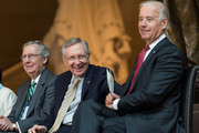 (L-R)  Senate Minority Leader Mitch McConnell (R-KY), Senate Majority Leader Harry Reid (D-NV) and U.S. Vice President Joe Biden laugh during a dedication ceremony for the new Frederick Douglass Statue in Emancipation Hall in the Capitol Visitor Center, at the U.S. Capitol, on June 19, 2013 in Washington, DC. The 7 foot bronze statue of Douglass joins fellow black Americans Rosa Parks, Martin Luther King Jr. and Sojourner Truth on permanent display in the Capitol's Emancipation Hall.