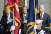 (L-R) Senate Majority Leader Harry Reid (D-NV), Speaker of the House John Boehner (R-OH), and U.S. Vice President Joe Biden are seen during the presentation of colors during a dedication ceremony for the new Frederick Douglass Statue in Emancipation Hall in the Capitol Visitor Center, at the U.S. Capitol, on June 19, 2013 in Washington, DC. The 7 foot bronze statue of Douglass joins fellow black Americans Rosa Parks, Martin Luther King Jr. and Sojourner Truth on permanent display in the Capitol's Emancipation Hall.