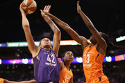 Brittney Griner #42 of the Phoenix Mercury attempts a shot over Chiney Ogwumike #13 of the Connecticut Sun during the first half of WNBA game at Talking Stick Resort Arena on July 5, 2018 in Phoenix, Arizona. NOTE TO USER: User expressly acknowledges and agrees that, by downloading and or using this photograph, User is consenting to the terms and conditions of the Getty Images License Agreement.