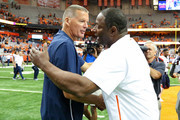 Head coach Randy Edsall (left) of the Connecticut Huskies and head coach Dino Babers (right) of the Syracuse Orange meet on the field following the game at the Carrier Dome on September 22, 2018 in Syracuse, New York. Syracuse defeated Connecticut 51-21.