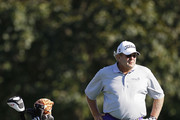 James Mason stands by his golf bag on the 18th fairway during the first round of the Constellation Energy Senior Players Championship held at TPC Potomac at Avenel Farm on October 7, 2010 in Potomac, Maryland.