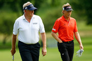 Colin Montgomerie of Scotland and Bernhard Langer of Germany walk the 14th green during the first round of the 2013 Constellation Senior Players Championship at Fox Chapel Golf Club on June 27, 2012 in Fox Chapel, Pennsylvania.