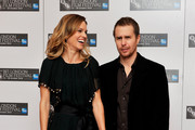 """Actress Hilary Swank (L) and actor Sam Rockwell pose at the """"Conviction"""" photocall during the 54th BFI London Film Festival at the Vue West End on October 15, 2010 in London, England."""
