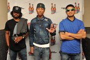 Hip-hop artists Shay Haley, Pharrell Williams, and Chad Hugo of N.E.R.D. backstage before their performance at the Coors Light Search for the Coldest National competition and tour at Highline Ballroom on May 31, 2011 in New York, New York.