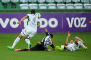 Carlinhos and Welliton of Coritiba competes for the ball with Marion of Atletico-MG during the match between Coritiba and Atletico-MG for the Brazilian Series A 2014 at Couto Pereira stadium on August 31, 2014 in Curitiba, Brazil.