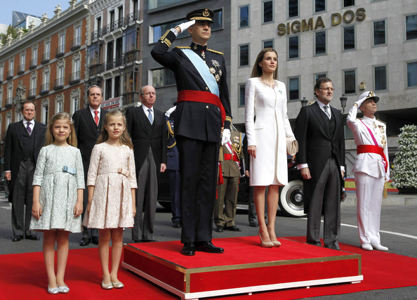 (L-R) Princess Sofia, Princess Leonor, Princess of Asturias, King Felipe VI of Spain, Queen Letizia of Spain, Prime Minister Mariano Rajoy and General Admiral Fernando García Sanchez watch a parade of Civil Guard at the Congress of Deputies prior to the King's official coronation ceremony on June 19, 2014 in Madrid, Spain. The coronation of King Felipe VI is held in Madrid. His father, the former King Juan Carlos of Spain abdicated on June 2nd after a 39 year reign. The new King is joined by his wife Queen Letizia of Spain.