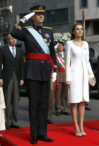 King Felipe VI of Spain and Queen Letizia of Spain watch a parade of Civil Guard at the Congress of Deputies prior to the King's official coronation ceremony on June 19, 2014 in Madrid, Spain. The coronation of King Felipe VI is held in Madrid. His father, the former King Juan Carlos of Spain abdicated on June 2nd after a 39 year reign. The new King is joined by his wife Queen Letizia of Spain.