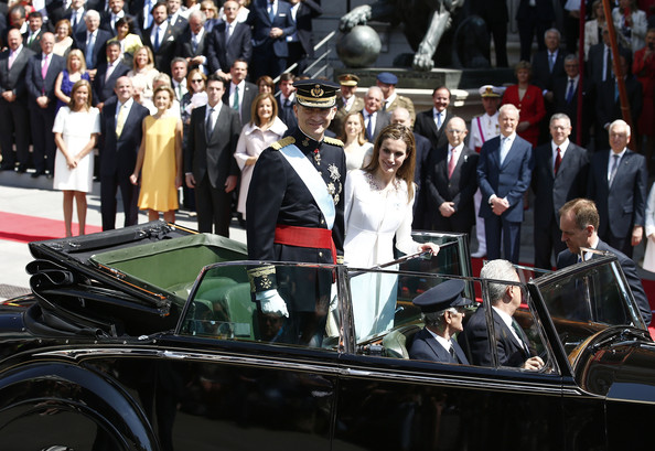 King Felipe VI of Spain and Queen Letizia of Spain leave the Congress of Deputies during the King's official coronation ceremony on June 19, 2014 in Madrid, Spain. The coronation of King Felipe VI is held in Madrid. His father, the former King Juan Carlos of Spain abdicated on June 2nd after a 39 year reign. The new King is joined by his wife Queen Letizia of Spain.