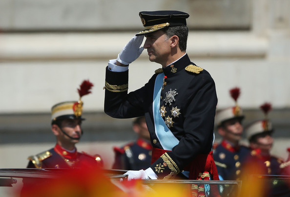 King Felipe VI greets crowds of wellwishers as he arrives at the Royal Palace during the King's official coronation ceremony on June 19, 2014 in Madrid, Spain. The coronation of King Felipe VI is held in Madrid. His father, the former King Juan Carlos of Spain abdicated on June 2nd after a 39 year reign. The new King is joined by his wife Queen Letizia of Spain.