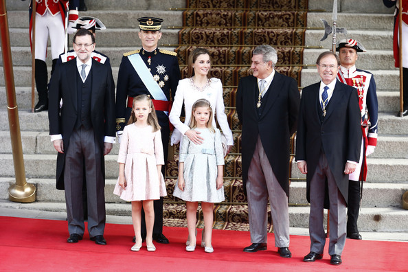 Prime Minister Mariano Rajoy (L) stands with King Felipe VI of Spain and Queen Letizia of Spain, Princess Leonor,  Princess of Asturias and Princess Sofia infront of the Lions Gate at the Congress of Deputies during the King's official coronation ceremony on June 19, 2014 in Madrid, Spain. The coronation of King Felipe VI is held in Madrid. His father, the former King Juan Carlos of Spain abdicated on June 2nd after a 39 year reign. The new King is joined by his wife Queen Letizia of Spain.
