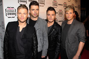 (UK TABLOID NEWSPAPERS OUT) Nicky Bryne, Kian Egan, Mark Feeily and Shane Filan of Westlife attend the Cosmopolitan Ultimate Women of the Year awards 2010 held at Banqueting House on November 2, 2010 in London, England.