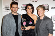 (UK TABLOID NEWSPAPERS OUT) Mark Feehily and Kian Egan of Westlife pose after presenting Christine Bleakley with her Best TV Presenter award in the press room at the Cosmopolitan Ultimate Women of the Year awards 2010 held at Banqueting House on November 2, 2010 in London, England.