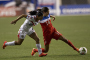 Christen Press #14 of the United States goes for the ball along with Shirley Cruz #10 of Cosat Rica in the first half in the 2014 CONCACAF Women's Championship final on October 26, 2014 at PPL Park in Chester, Pennsylvania. The United States defeated Cosat Rica 6-0