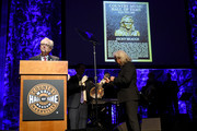Ricky Skaggs (R) is presented with his Hall of Fame plaque from CMHOF's Kyle Young during the 2018 Country Music Hall of Fame and Museum Medallion Ceremony honoring inductees Johnny Gimble, Ricky Skaggs and Dottie West at Country Music Hall of Fame and Museum on October 21, 2018 in Nashville, Tennessee.