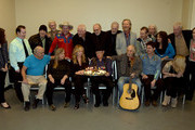 "(Back row, l-r): Charlie McCoy birthday with Country Music Hall of Fame and Museum's Abi Tapia,.Elliott Mazer, Ron Cornelius, Old Crow Medicine Show's Critter Fuqua,.Jon Langford, Norbert Putnam, David Briggs, Mac Gayden, Lloyd Green,.Wayne Moss, Wanda Vick, and co-curator Pete Finney, and Country Music.Hall of Fame and Museum's Abigail St. Pierre. (Front row, l-r) Kenny.Malone, Tracy Nelson, Deana Carter, Charlie McCoy, Steve Young, Old.Crow Medicine Show's Ketch Secor, and Oceana Gayden backstage during, Listen To The Band: The Nashville Cats In Concert With Special Guests For ""Dylan, Cash, And The Nashville Cats"" Exhibition Opening Weekend at the Country Music Hall of Fame and Museum on March 28, 2015 in Nashville, Tennessee."