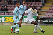 Jabo Ibehre of Colchester United looks for the ball with Jordan Clarke of Coventry City during the Sky Bet League One match between Coventry City and Colchester United at Sixfields Stadium on September 8, 2013 in Northampton, England.