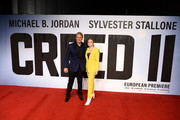 """Dolph Lundgren and Greta Lundgren attend the European Premiere of """"Creed II"""" at BFI IMAX on November 28, 2018 in London, England."""