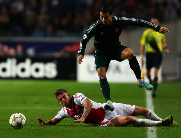 Cristiano Ronaldo rides a challenge from Ajax's Toby Alderweireld in the previous meeting between tonight's side, but who will form tonight's starting line-up for both teams?