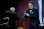 "Joey Fatone (R) presents award for Best Competition Series: Talent/ Variety to Executive Producers for ""The Masked Singer"" onstage  onstage during the Critics' Choice Real TV Awards at The Beverly Hilton Hotel on June 02, 2019 in Beverly Hills, California."