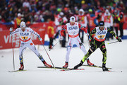 Marcus Hellner (L) of Sweden competes with Anders Gloeersen of Norway and Robin Duvillard of France during the Men's 4 x 10km Cross-Country Relay during the FIS Nordic World Ski Championships at the Lugnet venue on February 27, 2015 in Falun, Sweden.