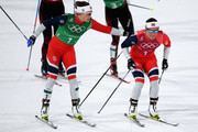 Maiken Caspersen Falla of Norway (L) and Marit Bjoergen of Norway handover during the Cross Country Ladies' Team Sprint Free Final on day 12 of the PyeongChang 2018 Winter Olympic Games at Alpensia Cross-Country Centre on February 21, 2018 in Pyeongchang-gun, South Korea.
