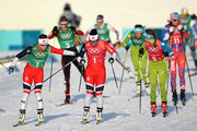 Marit Bjoergen of Norway (1-1) and Maiken Caspersen Falla of Norway handover during the Cross Country Ladies' Team Sprint Free semi final on day 12 of the PyeongChang 2018 Winter Olympic Games at Alpensia Cross-Country Centre on February 21, 2018 in Pyeongchang-gun, South Korea.