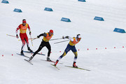 Marcus Hellner of Sweden, Lucas Boegl of Germany and Russell Kennedy of Canada compete during Cross-Country Skiing men's 4x10km relay on day nine of the PyeongChang 2018 Winter Olympic Games at Alpensia Cross-Country Center on February 18, 2018 in Pyeongchang-gun, South Korea.