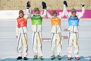 Gold medalists Lars Nelson, Daniel Richardsson, Johan Olsson, Marcus Hellner of Sweden celebrate during the flower ceremony for the Cross Country Men's 4 x 10 km Relay during day nine of the Sochi 2014 Winter Olympics at Laura Cross-country Ski & Biathlon Center on February 16, 2014 in Sochi, Russia.