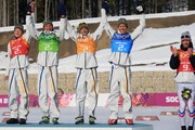 (L to R) Gold medalists Lars Nelson, Daniel Richardsson, Johan Olsson, Marcus Hellner of Sweden celebrate on the podium during the flower ceremony for the Cross Country Men's 4 x 10 km Relay during day nine of the Sochi 2014 Winter Olympics at Laura Cross-country Ski & Biathlon Center on February 16, 2014 in Sochi, Russia.