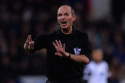 Referee Mike Dean during the Barclays Premier League match between Crystal Palace and Norwich City at Selhurst Park on January 1, 2014 in London, England.