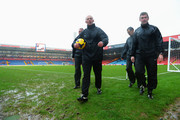 Referee Mike Dean (2nd L) and his assistants inspect the pitch conditions before the Barclays Premier League match between Crystal Palace and Norwich City at Selhurst Park on January 1, 2014 in London, England.