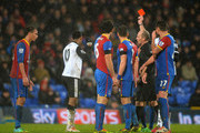 Leroy Fer of Norwich is sent off by referee Mike Dean during the Barclays Premier League match between Crystal Palace and Norwich City at Selhurst Park on January 1, 2014 in London, England.
